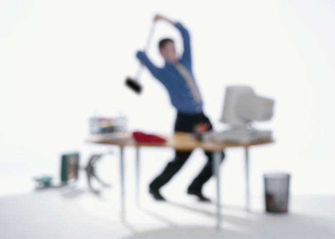 man smashing computer