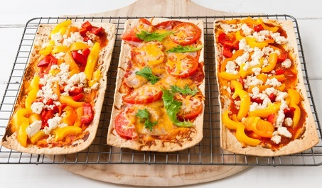 Baked flatbread with variety of toppings.